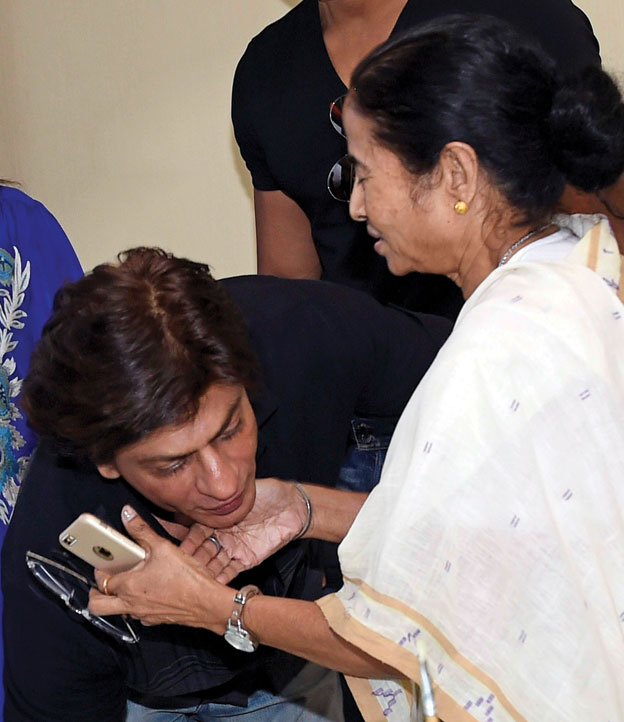 "West Bengal Chief Minister Mamata Banerjee and Shahrukh Khan at the CM's office in Kolkata. Shahrukh and other stars of ""Happy New Year"" were in Kolkata to promote their film. [Ashok Bhaumik 