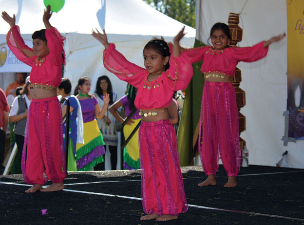 (Above): Kids performing at this year's Diwali celebrations in Cupertino, Calif. The event had a lot to offer in booths and kids' activities in addition to the non-stop live performances. [Photo: Amar D. Gupta | Siliconeer]