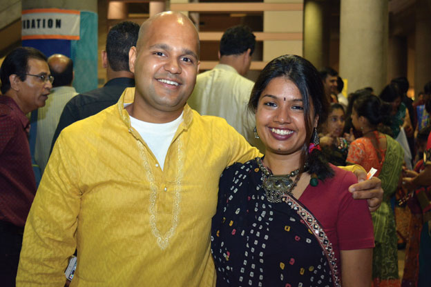 (Above): A young Silicon Valley couple looking forward to an evening of fun and masti at the Sankara Eye Foundation Dandia and Raas Garba event, Oct. 4, at the Santa Clara Convention Center. [Photo: Amar D. Gupta | Siliconeer]