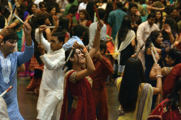 (Above): The crowd engages in Dandia moves at the Sankara Eye Foundation Dandia and Raas Garba event, Oct. 4, at the Santa Clara Convention Center. [Photo: Amar D. Gupta | Siliconeer]