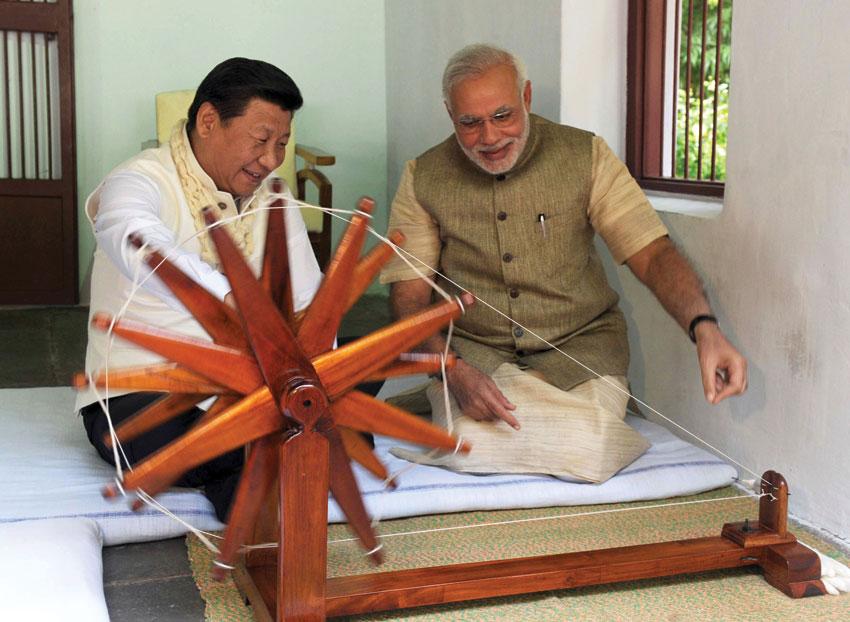 Prime Minister Narendra Modi and Chinese President Xi Jinping at the Sabarmati Ashram in Ahmedabad, Gujarat, Sep. 17. (Press Information Bureau)
