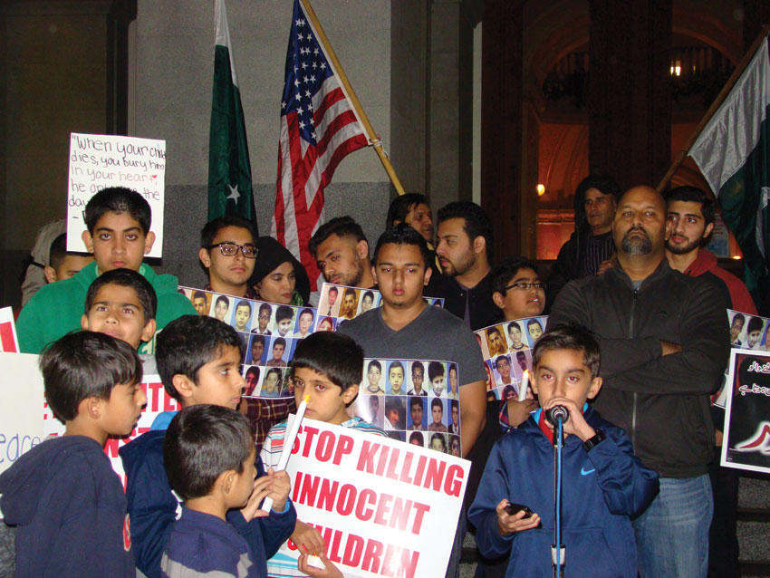 Children addressing the vigil to protest the terror attacks in an Army school in Pakistan, in Sacramento, Dec. 20.