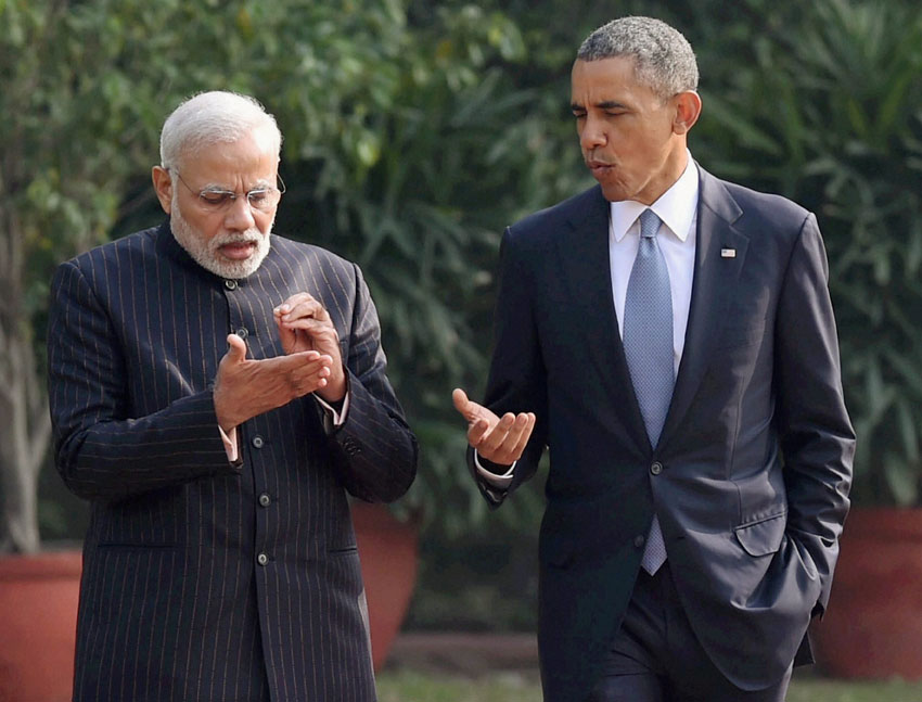 Prime Minister Narendra Modi and U.S. President Barack Obama chat on key issues as they stroll in the gardens of Hyderabad House in New Delhi, Jan. 25. (Atul Yadav | PTI)