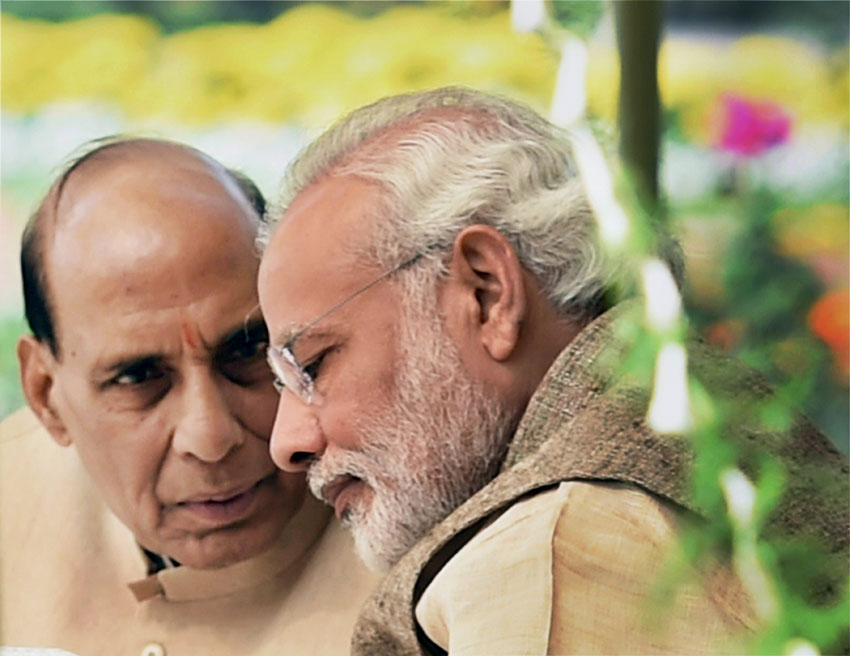 Union Home Minister Rajnath Singh and Prime Minister Narendra Modi during a lunch hosted for the Governors attending the 46th Governors Conference, at the Rashtrapati Bhavan in New Delhi, Feb. 12. (Subhav Shukla | PTI)