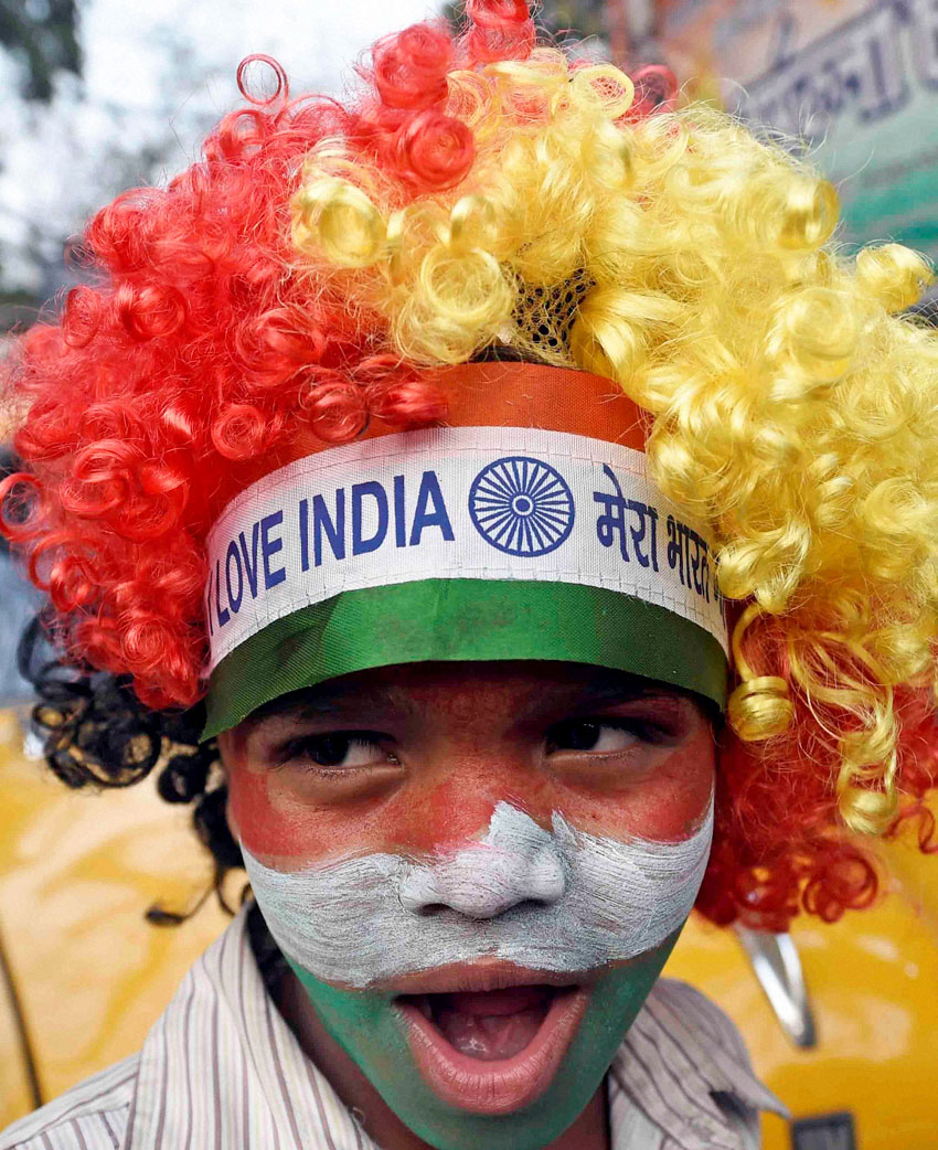 A cricket fan celebrates India's victory against South Africa in ICC Cricket World Cup at Kolkata, Feb. 22.   (Ashok Bhaumik | PTI)
