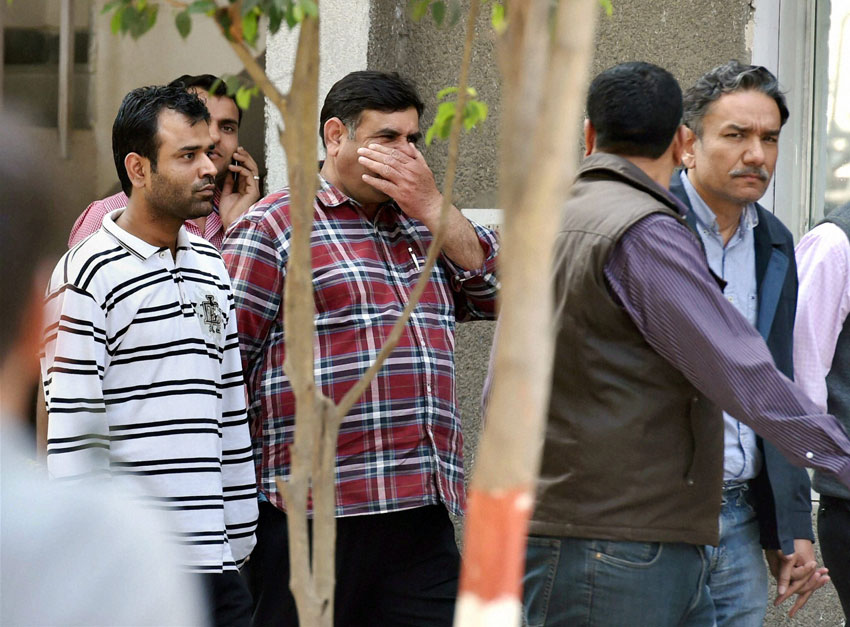 Former journalist Santanu Saikia (r) along with other accused in corporate espionage scandal at Special Cell of Delhi Police before they were produced at a court in Delhi, Feb. 21. (Atul Yadav | PTI)