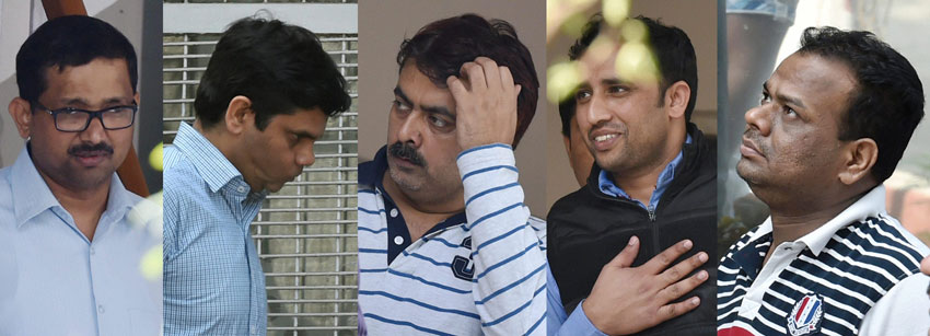 Five senior executives from top energy firms, arrested in connection with corporate espionage scandal, before they were produced in a court in New Delhi, Feb. 21. (Atul Yadav | PTI)