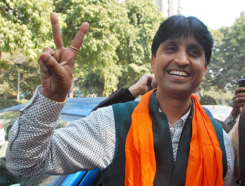 AAP leader Kumar Vishwas arrives at the party office in Kaushambi, Feb. 10, after the party's win in Delhi Assembly polls. (Press Trust of India)