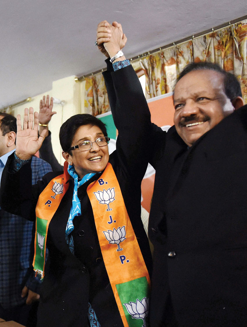 BJP Chief Minister candidate Kiran Bedi with Science and Technology minister Harsh Vardhan at an election campaign in Krishna Nagar area in New Delhi, Jan. 20. (Atul Yadav | PTI)