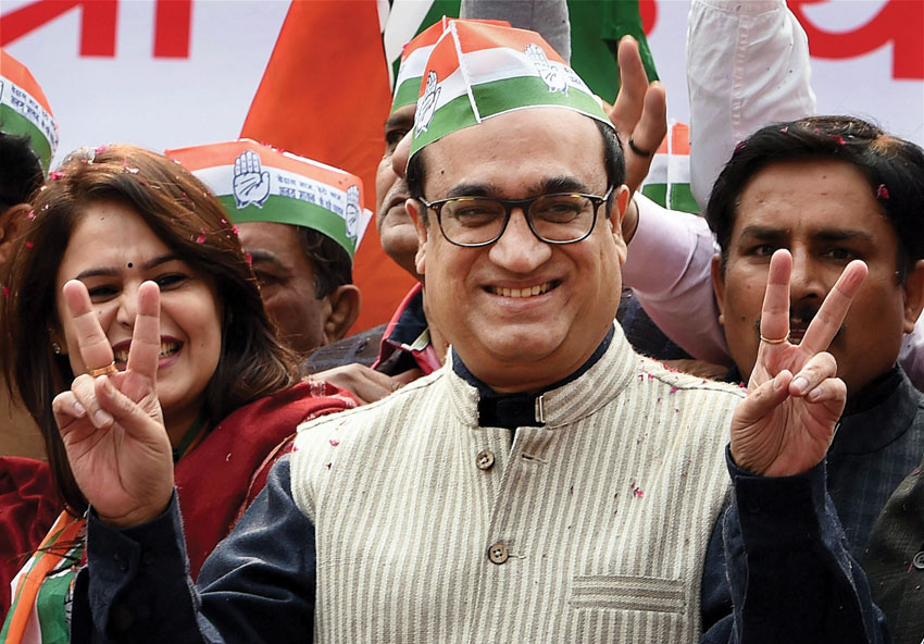 Congress candidate from Sadar Bazar, Ajay Maken, seen with his supporters at his nomination filing procession for Assembly elections, in New Delhi, Jan. 21. (Shahbaz Khan | PTI)