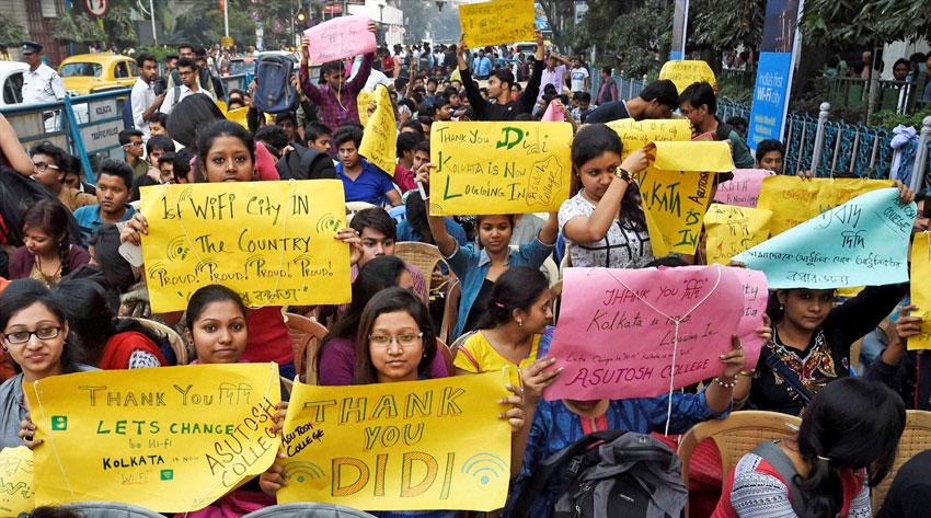 FREE TO ROAM: People display placards at the inauguration of first Wi-Fi City in Kolkata, Feb. 5. (Ashok Bhaumik   PTI)