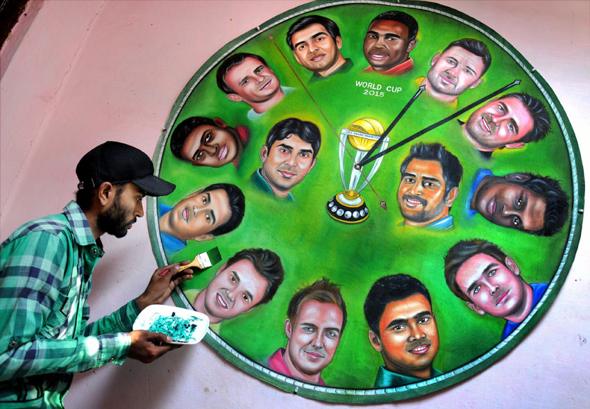 An Amritsar-based artist gives final touch to a painting, featuring all the fourteen captains of cricket world cup teams, in Amritsar, Feb. 11. (Press Trust of India)