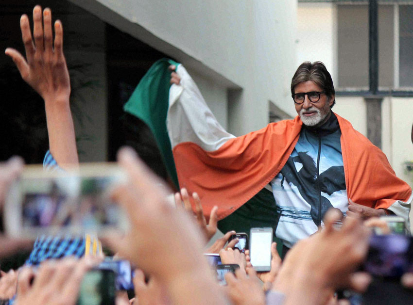 Amitabh Bachchan celebrates after India won their first match against Pakistan in ICC Cricket World Cup 2015, in Mumbai, Feb. 15. (Press Trust of India)