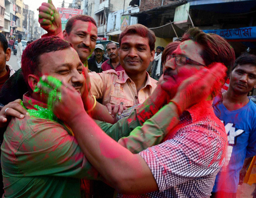 People celebrate team India's victory against Pakistan in ICC World Cup cricket match, in Allahabad, Feb. 15. (Press Trust of India)