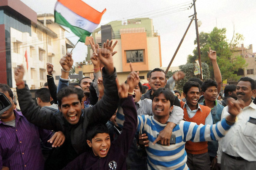 Cricket fans celebrate in front of Indian Skipper Mahendra Singh Dhoni's residence after team India's victory against Pakistan in ICC Cricket World Cup match, in Ranchi, Feb. 15. (Press Trust of India)