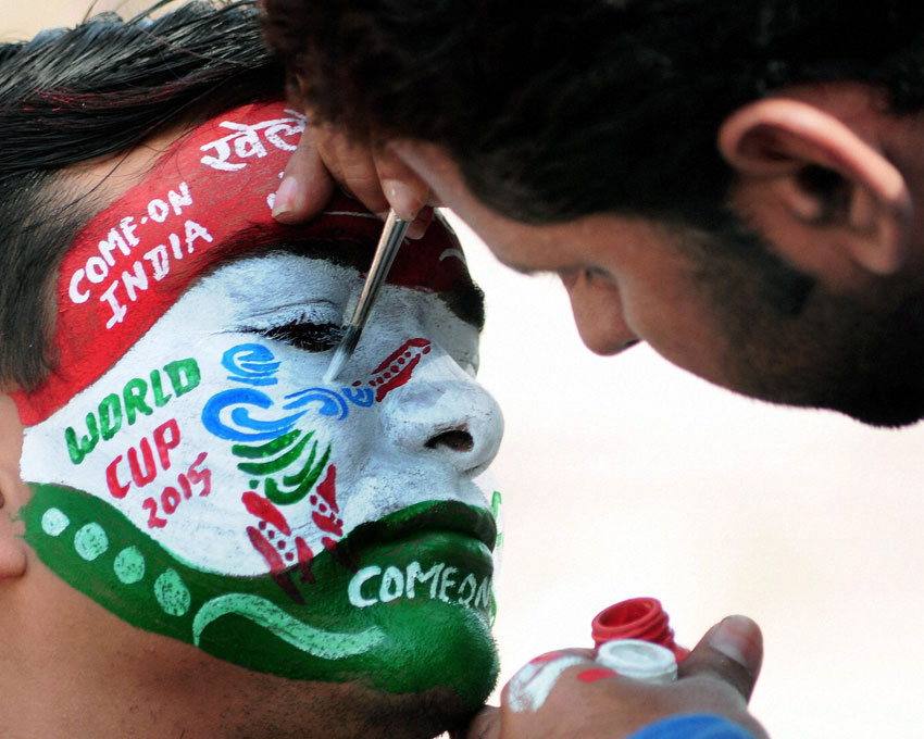 A cricket fan gets his face painted to wish good luck to team India for the ICC Cricket World Cup 2015 in Bikaner, Feb. 13. (Press Trust of India)