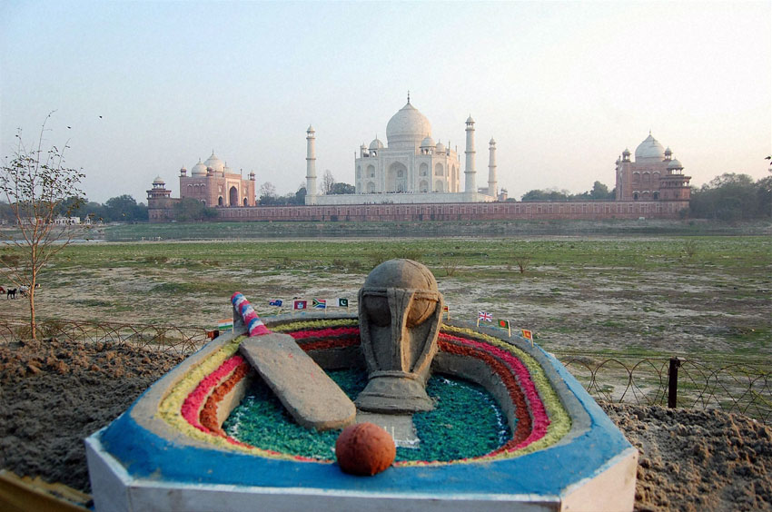 Sand artist Sudarshan Patnaik creates a sand image on ICC World Cup 2015 near the Taj Mahal in Agra, Feb. 13. (Press Trust of India)