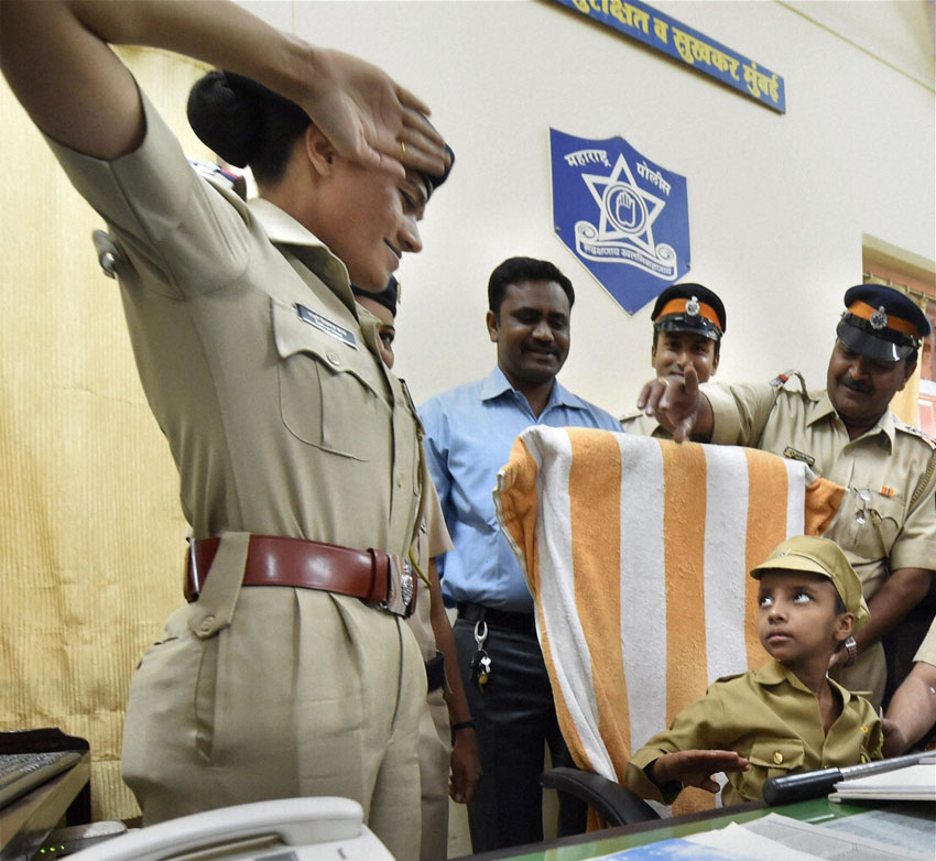 KID COP: Seven-year-old Mahak Singh, suffering from cancer, gets her wish to become a police officer completed at Bhoiwada police station in Mumbai, Feb. 13. (Santosh Hirlekar | PTI)