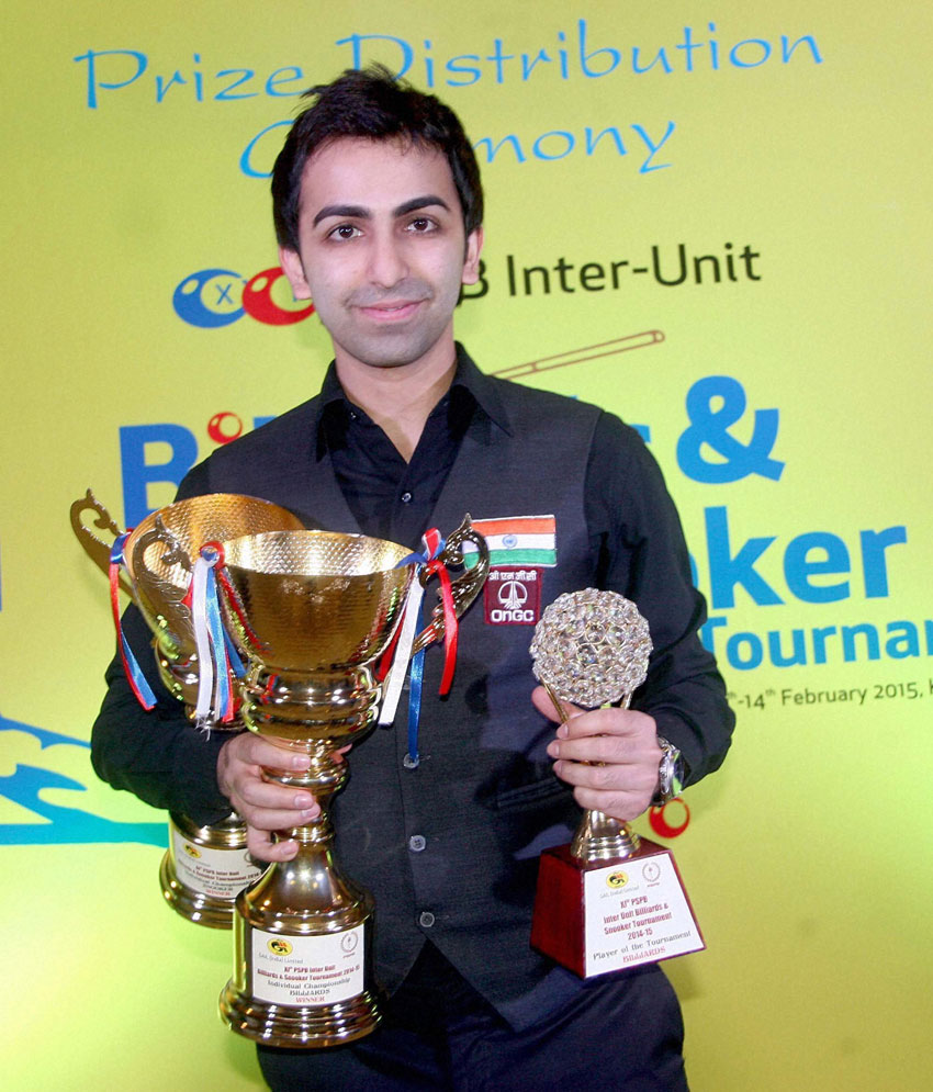 "WORLD CHAMP: World billiards and snooker champion Pankaj Advani who won both billiards and snooker tournament finals of ""XI PSPB Iner-Unit Billiards and Snooker tournament"" with trophy during award ceremony in Bengaluru, Feb. 14. (Press Trust of India)"