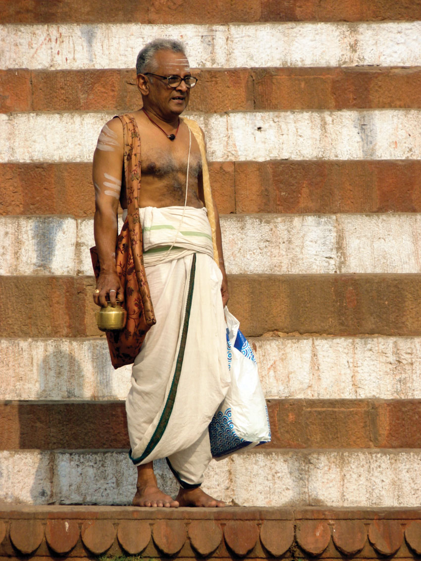 A worshipper at the banks of river Ganga in Varanasi, India.