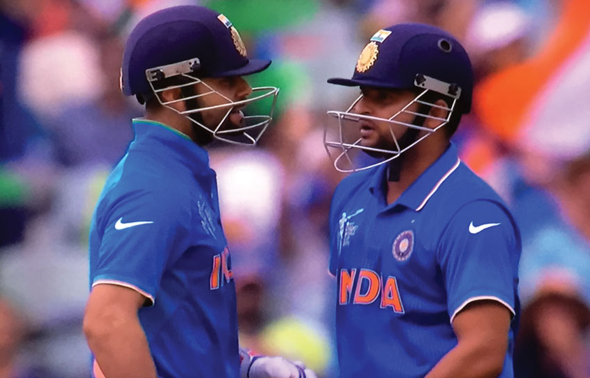 India's Virat Kohli and Suresh Raina pause for a chat in between overs at the 2015 World Cup Cricket Pool B game against Pakistan, in Adelaide, Feb. 15.
