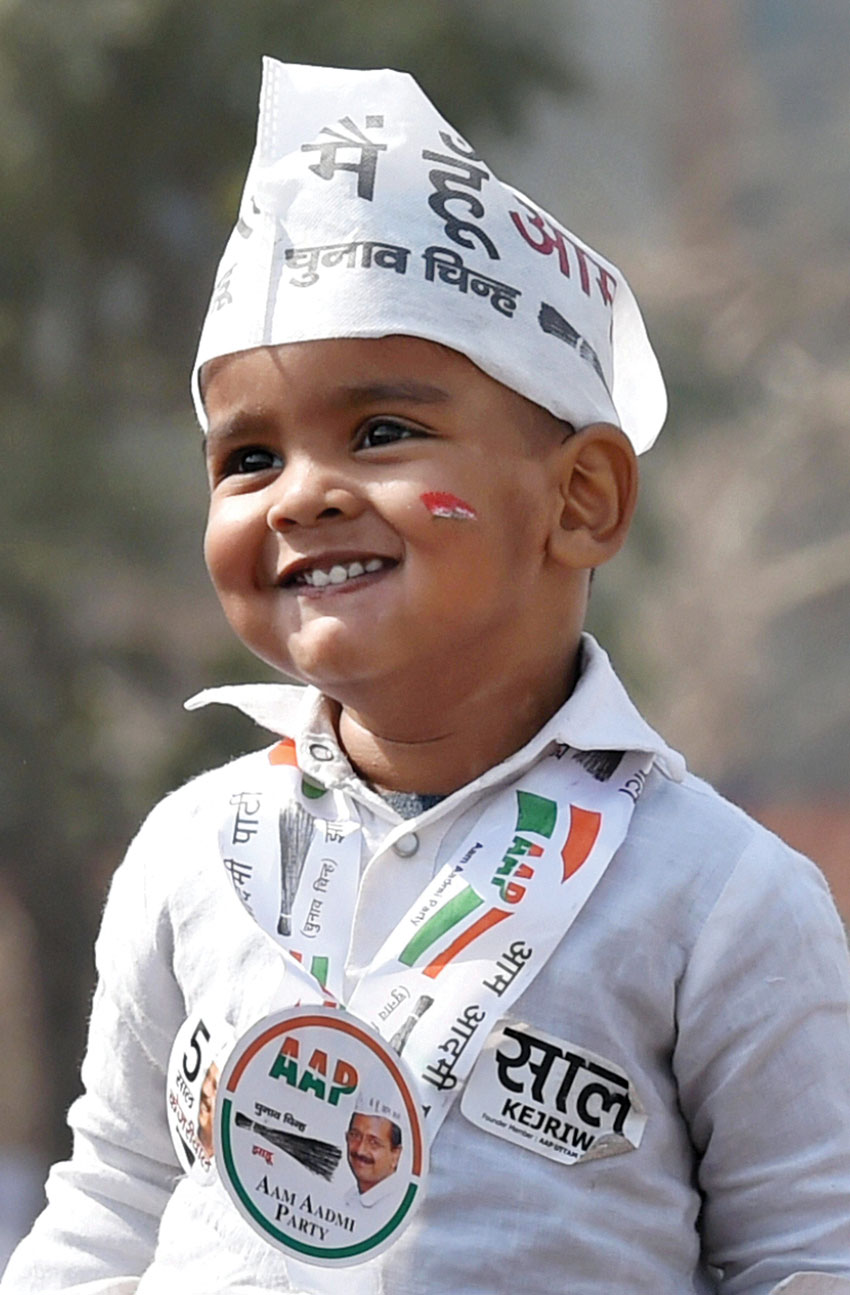 A child in an AAP supporter's get up during the oath ceremony of Delhi Chief Minister Arvind Kejriwal at Ramlila Maidan in New Delhi, Feb. 14. (Atul Yadav  | PTI)