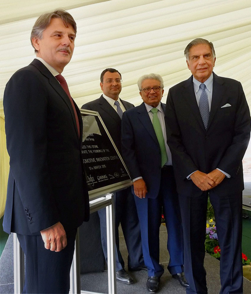 Tata Chairman Emeritus Ratan Tata (r) with Tata Group chairman Cyrus Mistry at the foundation stone laying ceremony for a new £150-million National Automative Innovation Centre at University of Warwick in Coventry, Mar. 18. Lord Kumar Bhattacharya, chairman of the Warwick Manufacturing Group, and Ralf Speth, CEO of Jaguar Land Rover are also seen. (Press Trust of India)