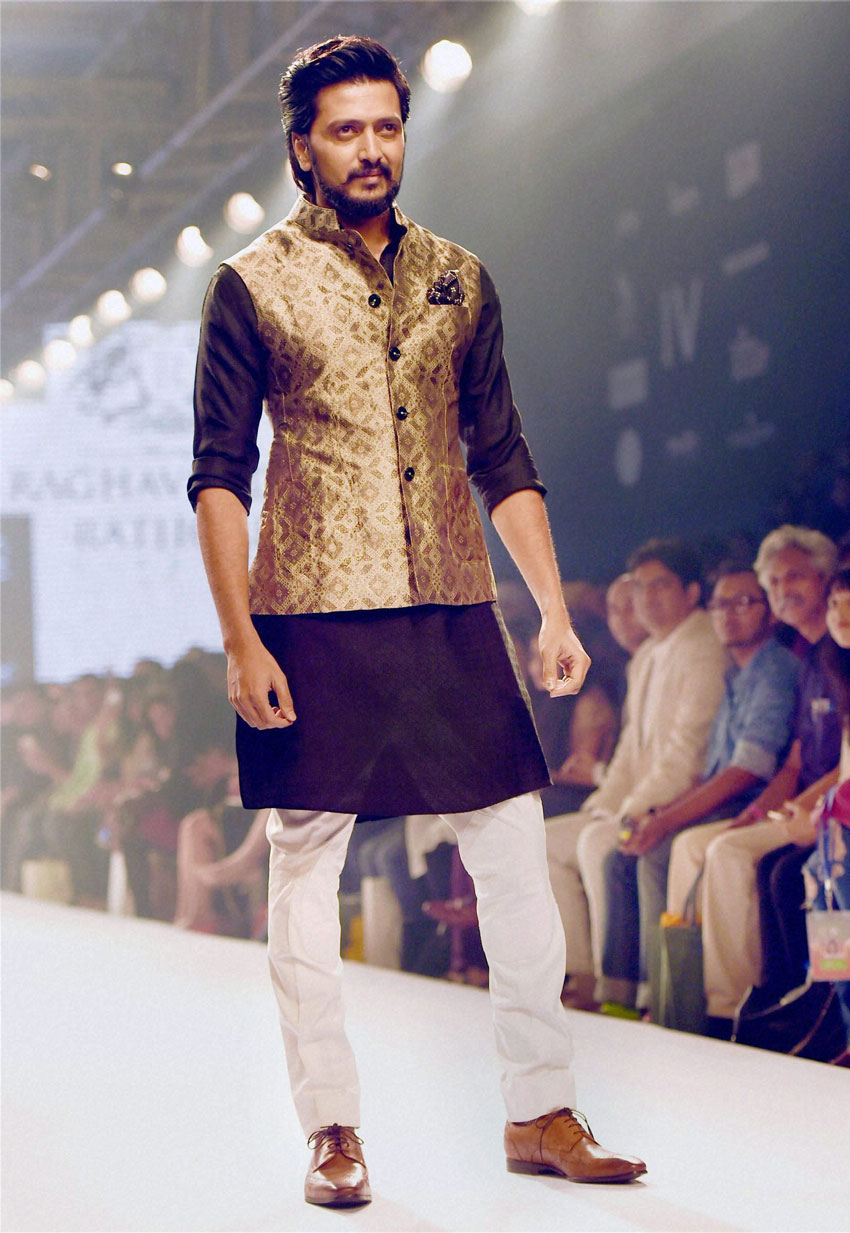 Bollywood actor Riteish Deshmukh walks the ramp during the Lakme´ Fashion Week Summer Resort 2015 in Mumbai. (Mitesh Bhuvad | PTI)