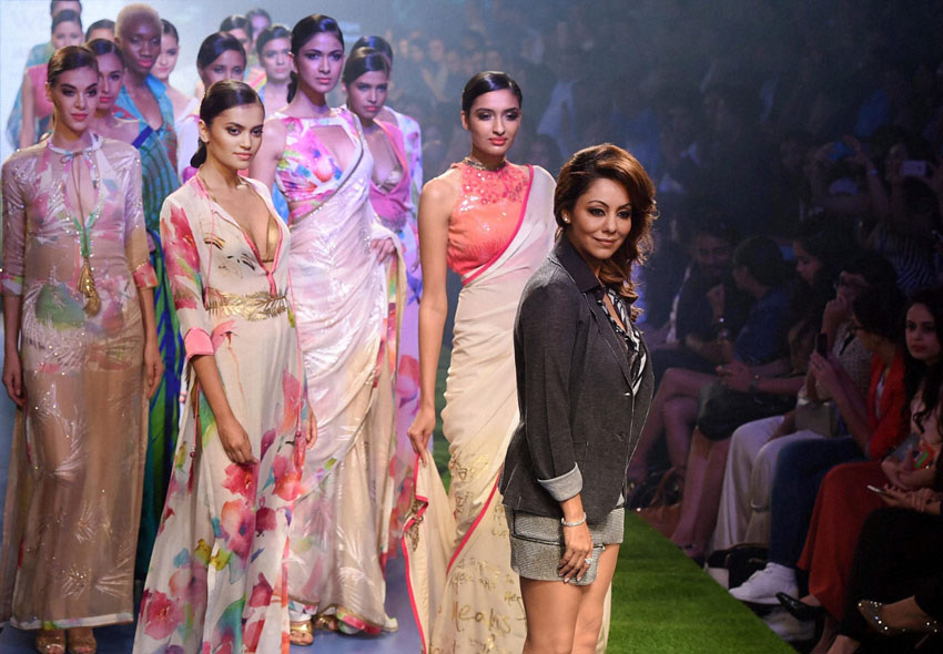 Gouri Khan, designer and wife of bollywood actor Shah Rukh Khan, with models during her show at the Lakme´ Fashion Week Summer Resort 2015 in Mumbai. (Shashank Parade | PTI)