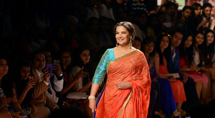 Bollywood actress Shabana Azmi walks the ramp during the Lakme´ Fashion Week Summer Resort 2015 in Mumbai. (Press Trust of India)