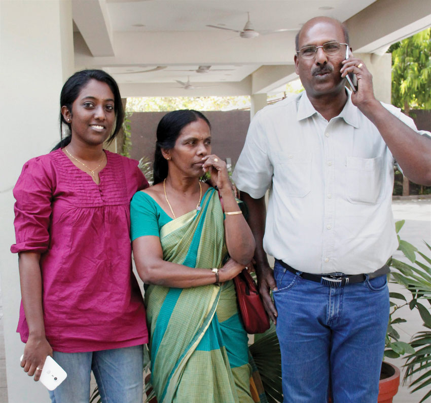Rinu Srinivasan with her parents, who was arrested for posting comments on the social networking site against the shutdown in Mumbai following Bal Thackeray's death reacts after the Supreme Court struck down Section 66 A of the IT Act, in Ahmedabad, Mar. 24. (Press Trust of India)