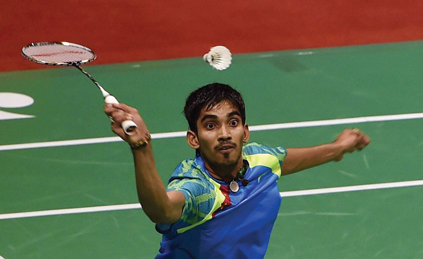 Indian badminton player K. Srikanth plays a shot against Denmark's Viktor Axelsen during the final match of Yonex Sunrise India Open 2015, in New Delhi, Mar. 29. (Shahbaz Khan | PTI)