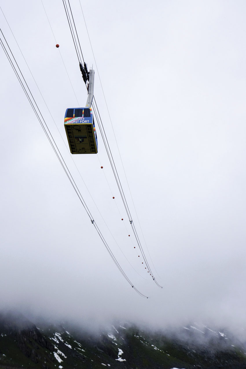 A cable car at Verbier ascends into the clouds.