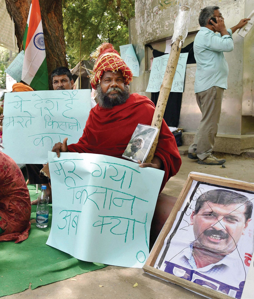 "People sit on a ""dharna"" at Jantar Mantar over farmer Gajender Singh's suicide, in New Delhi, Apr. 23. (Kamal Singh 