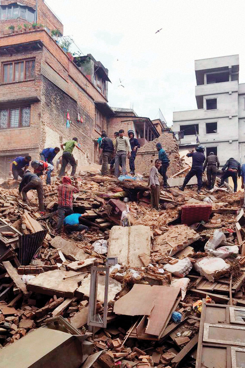 The debris of a collapsed building after a powerful earthquake in Kathmandu. (Press Trust of India)