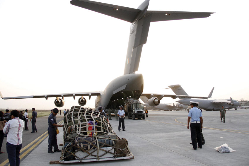 Relief materials being loaded into an Indian Air Force aircraft headed for Nepal, in New Delhi, Apr. 25. (Press Trust of India)