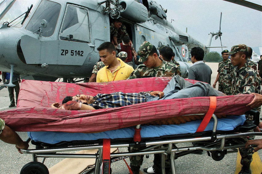 Army and IAF team shifting injured persons to safer places during their rescue operation for earthquake victims in Kathmandu, Apr. 27. (Press Trust of India)