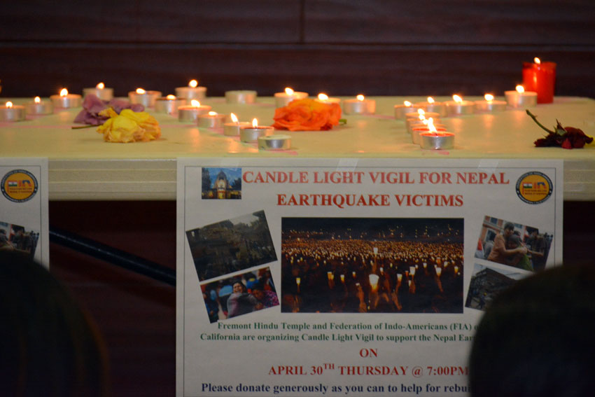 A sign and candles lit up as FIA of Northern California held a candlelight vigil and fundraiser at the Fremont Hindu Temple in support of the victims of Nepal Quake, Apr. 30. (Amar D. Gupta | Siliconeer)