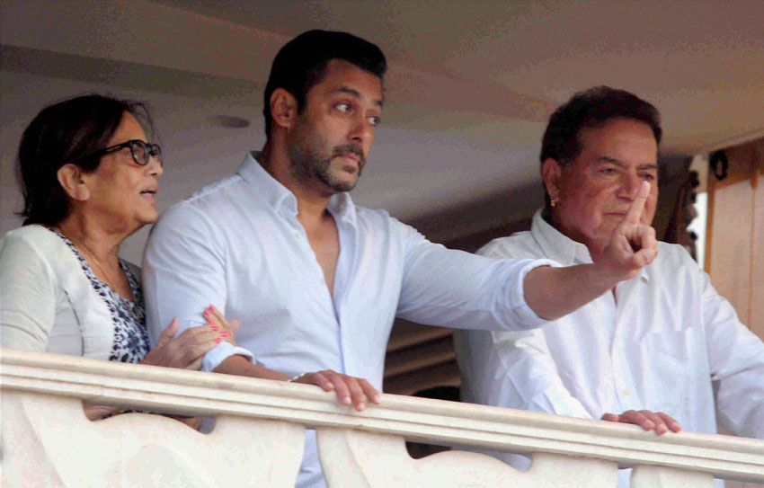 Salman Khan with father Salim Khan and mother Salma greets fans from his residence after returning from the Sessions Court in Mumbai, May 8. (Shashank Parade | PTI)