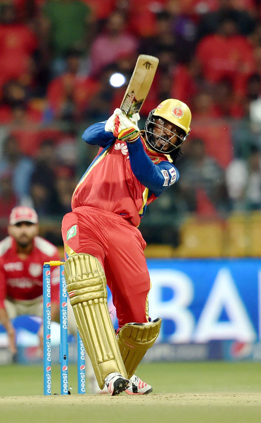 Royal Challengers Bangalore player Chris Gayle  plays a shot during IPL 8 match against Kings XI Punjab in Bengaluru, May 6. (Shailendra Bhojak | PTI)