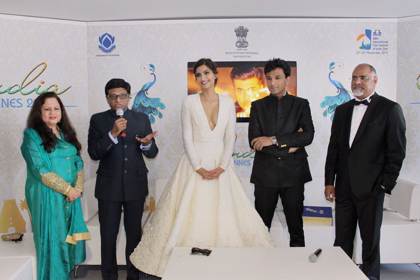 "Sonam Kapoor with Indian Ambassdor to France Mohan Kumar and Head of Global Marketing, Mastercard  Rajamannar  at the launch of the book ""UTSAV"" at Cannes Film Festival, May 17. (Press Trust of India)"