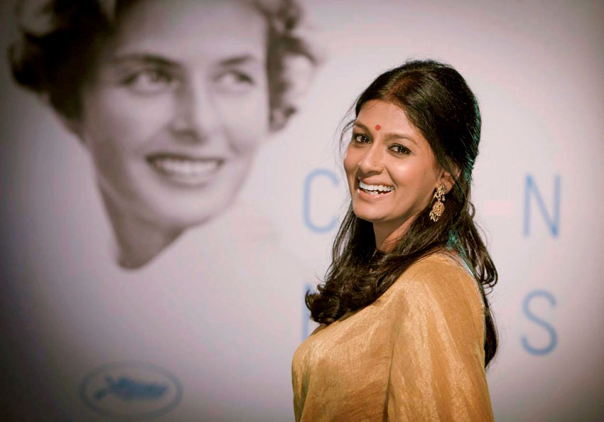 Bollywood actress Nandita Das stands next to a poster of Ingrid Bergman at Cannes Film Festival, May 13. The poster was chosen this year to pay tribute to Bergman for her contribution to film. (Press Trust of India)