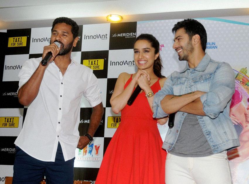 "Director Prabhu Deva, Shradha Kapoor (c) and Varun Dhawan (r), promoting their new movie ""ABCD 2"" in Bengaluru, Jun. 13. (Press Trust of India)"
