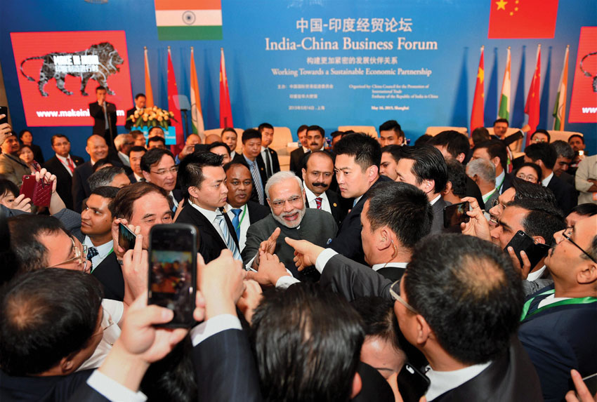 Prime Minister Narendra Modi shaking hands with business leaders at the India-China Business Forum in Shanghai, May 16. (Shahbaz Khan | PTI)