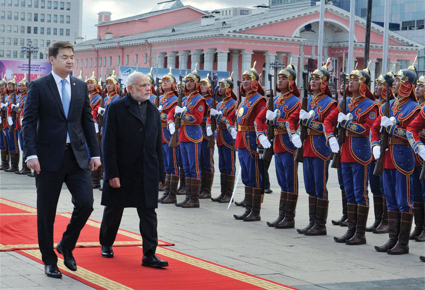 Prime Minster Narendra Modi walks with his Mongolian counterpart Chimed Saikhanbileg   as they inspect a guard of honor during the ceremonial welcome at State Palace  in Ulan Bator, Mongolia, May 17. (Shahbaz Khan | PTI)