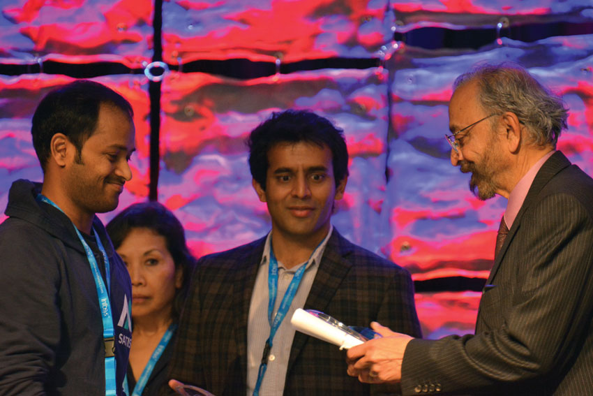 Serial entrepreneur and venture capitalist Suhas Patil (r) awarding one of the #TiE50 winners at #TiEcon 2015. Amar D. Gupta | Siliconeer