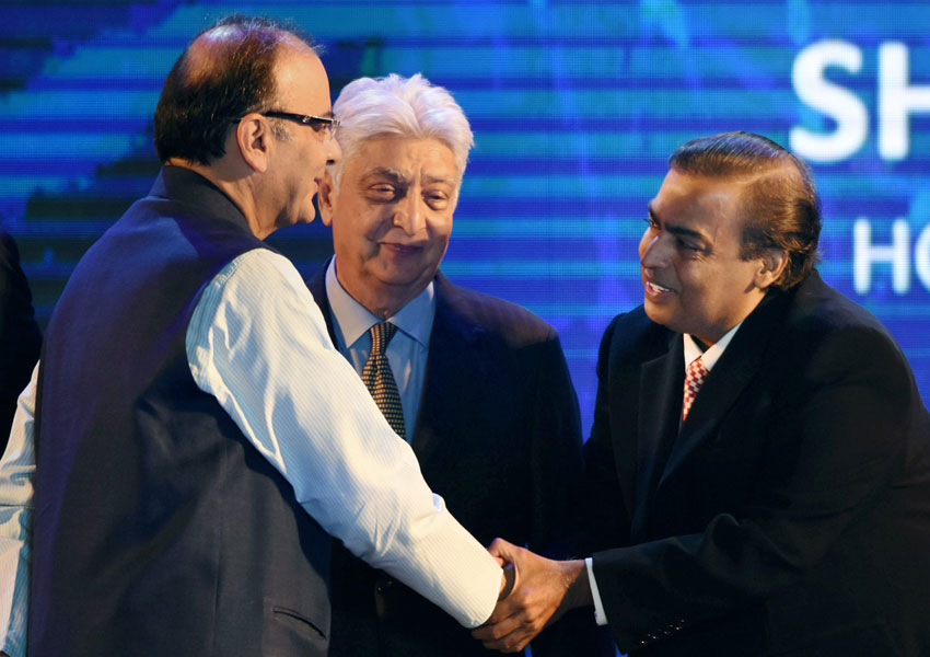 Finance Minister Arun Jaitley shakes hands with Reliance Industries chairman Mukesh Ambani as Wipro Chairman Azim Premji looks on at the launch of Digital India Week in New Delhi, July 1. (Manvender Vashist | PTI)