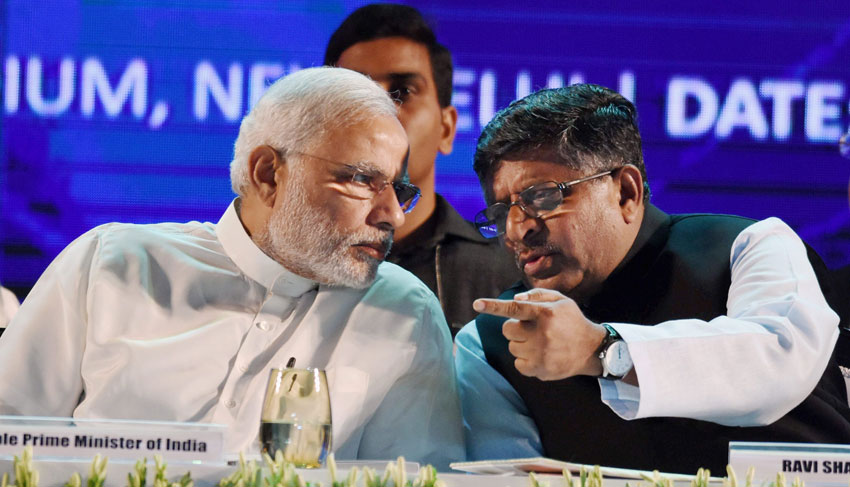Prime Minister Narendra Modi and Telecom Minister Ravishankar Prasad at the launch of Digital India Week. (Manvender Vashist | PTI)