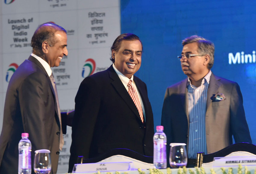 RIL chairman Mukesh Ambani, Bharti Enterprises chairman Sunil Mittal and Hero MotoCorp chairman Pawan Munjal at the launch of Digital India Week in New Delh, July 1. (Kamal Singh | PTI)