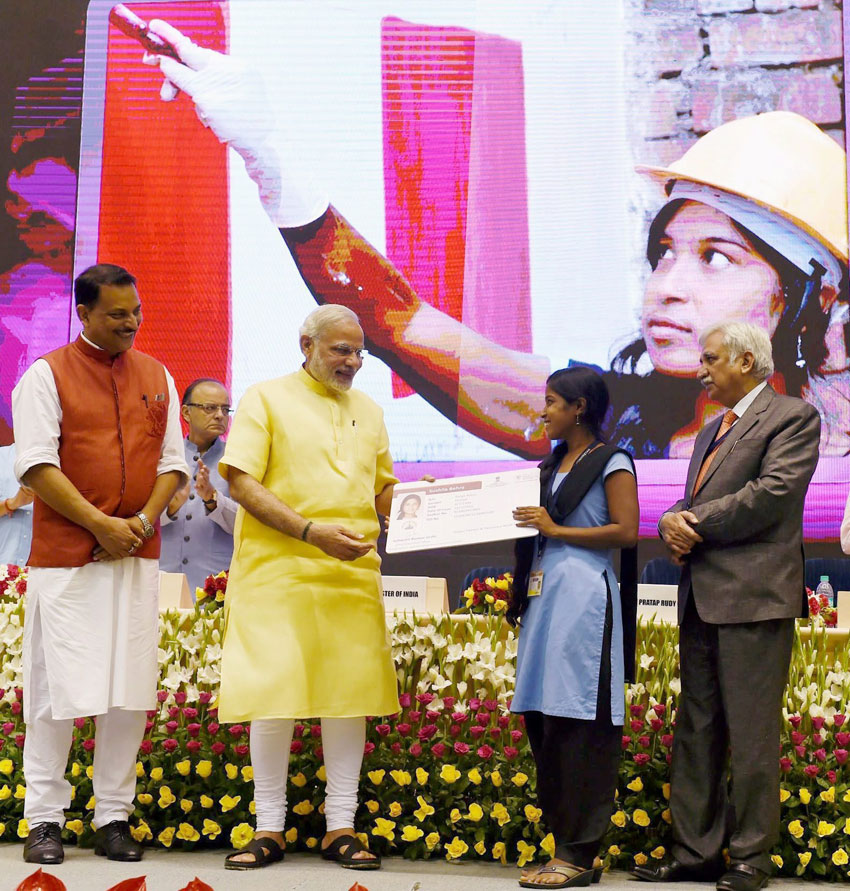 Prime Minister Narendra Modi awarding the certificate to a successful trainee under Pradhan Mantri Kaushal Vikas Yojna, at the launch of Skill India Campaign in New Delhi, July 15. (Subhav Shukla | PTI)